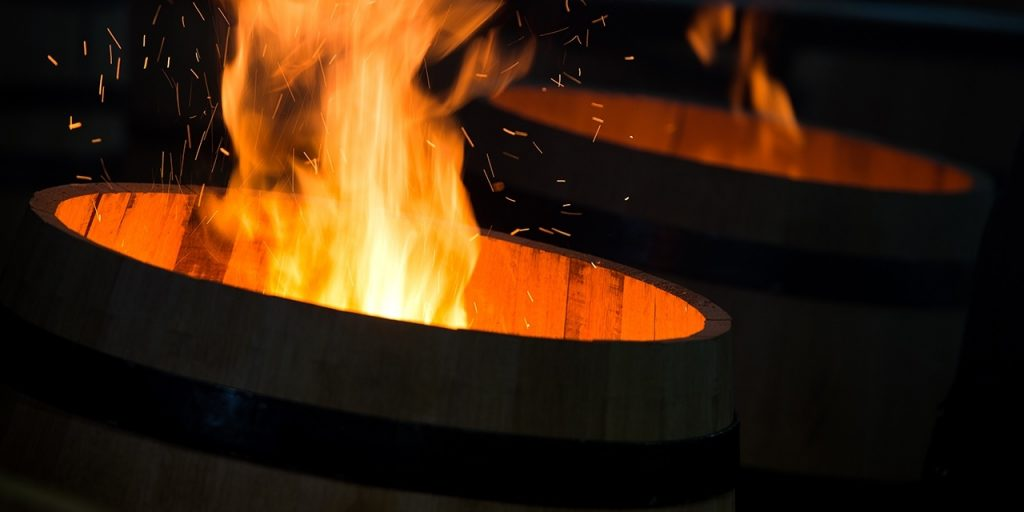 Image of barrels being charred with fire