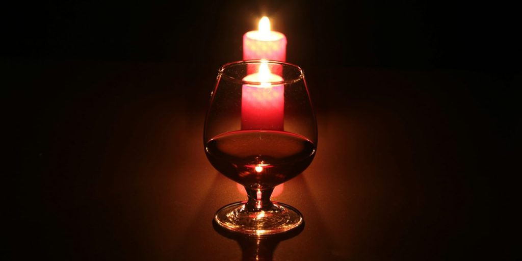 Image of a whisky glass and candle.