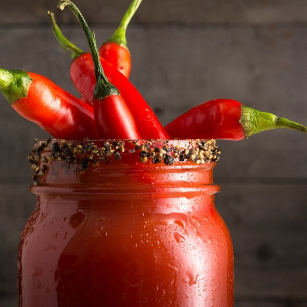 Caesar in a mason jar with hot peppers