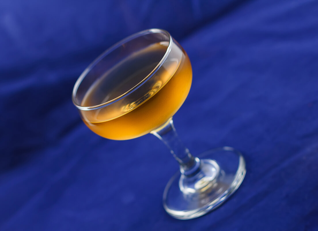 Corpse Reviver against a blue background