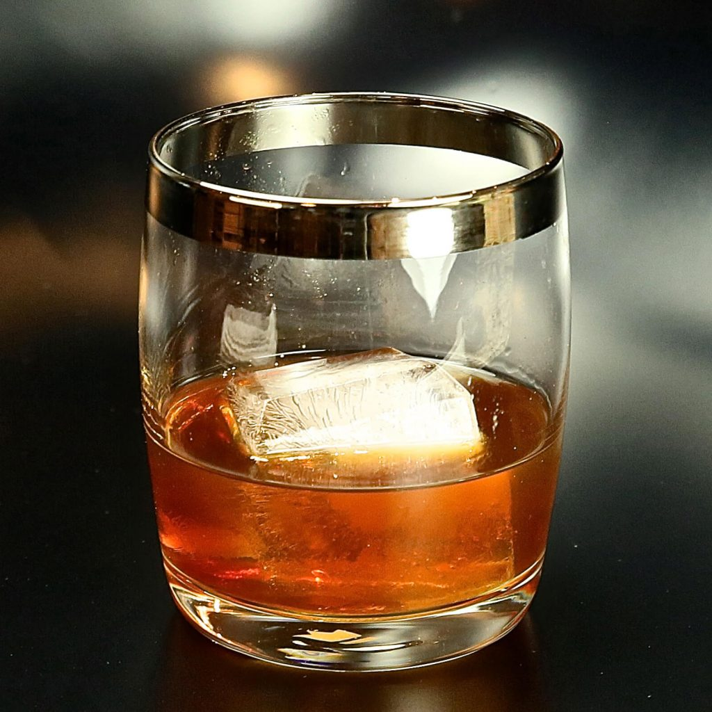 Image of barrel-aged rum in a glass