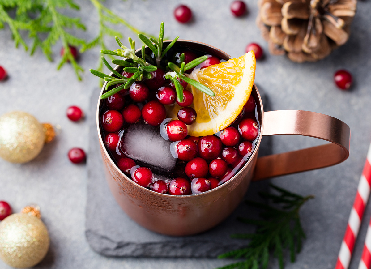 Moscow mule with pomegranate seeds and rosemary
