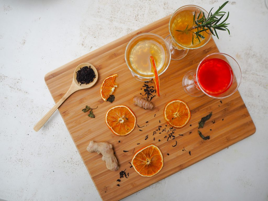 Image of ingredients used to flavour kombucha including orange slices, ginger