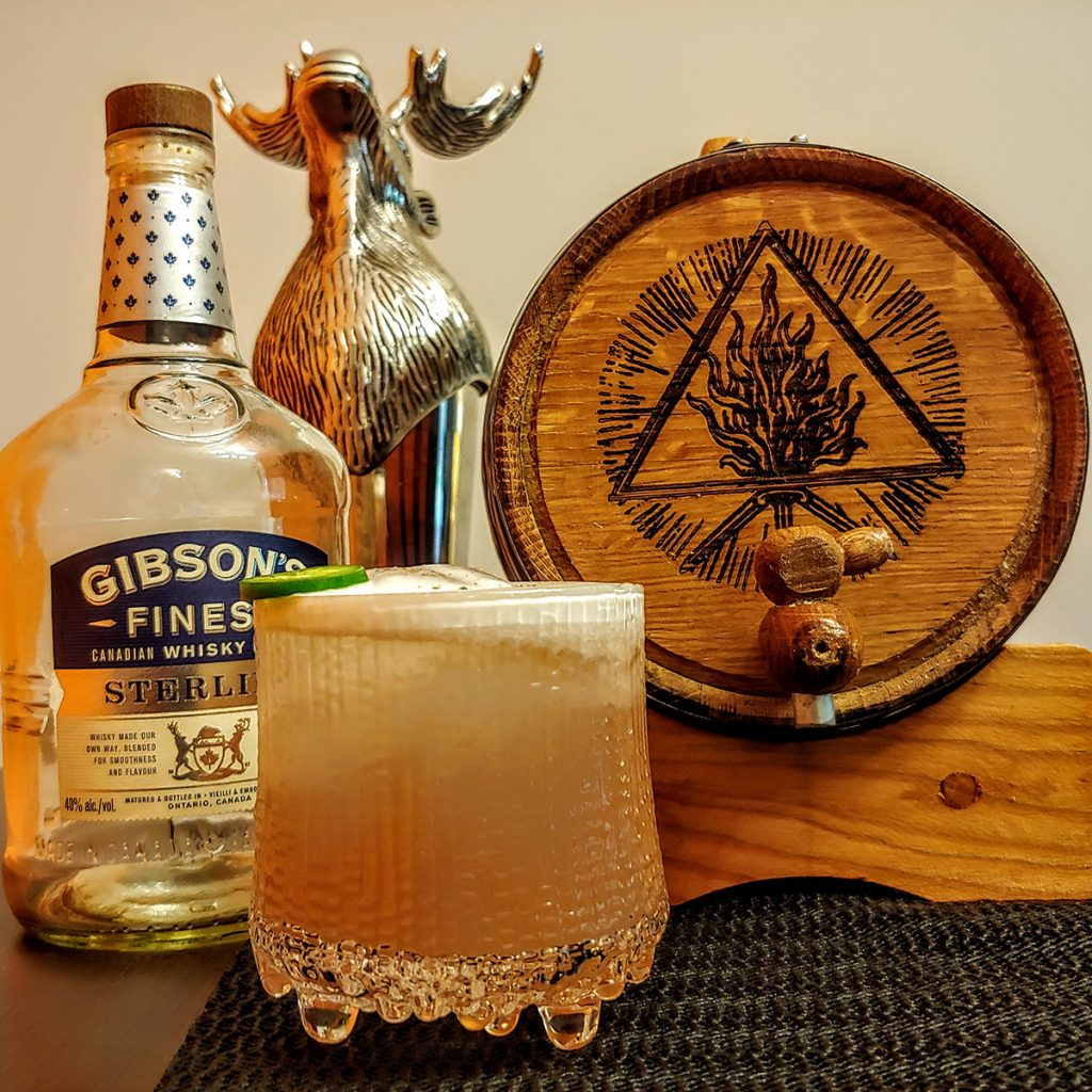 Image of a jalapeno whisky sour, Gibson's rye and an oak barrel