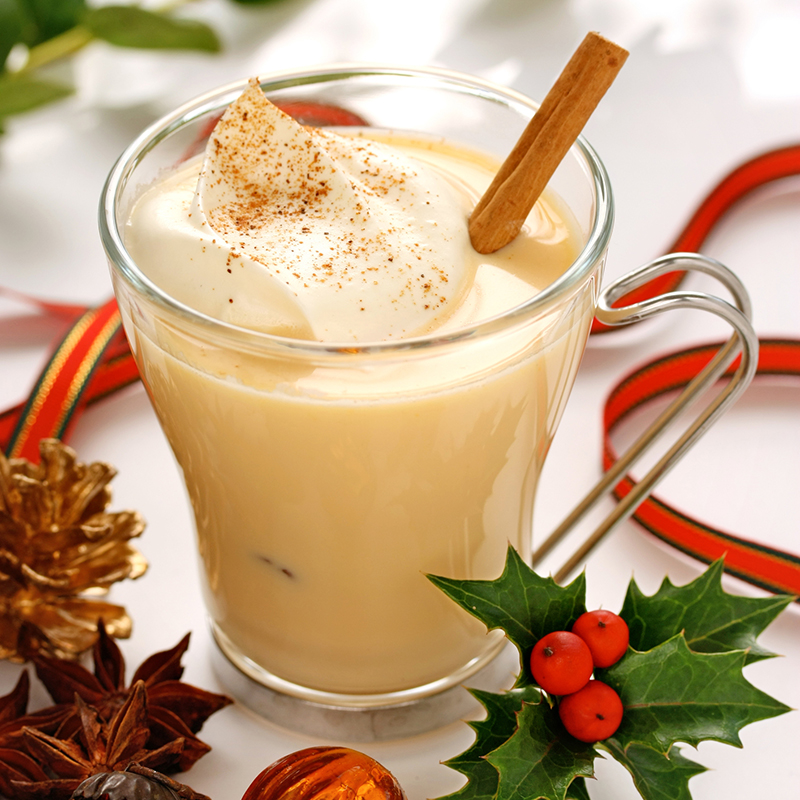 image of eggnog with a cinnamon stick