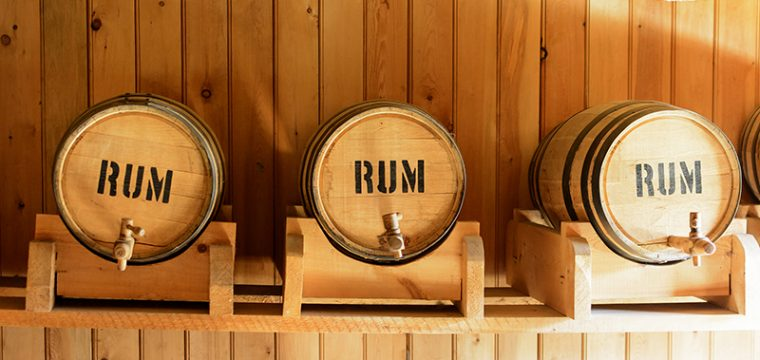 image of three barrels stamped with the word Rum