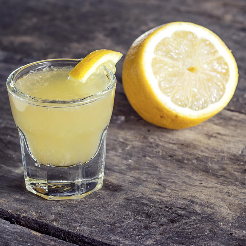 Image of a shot of limoncello with a lemon slice