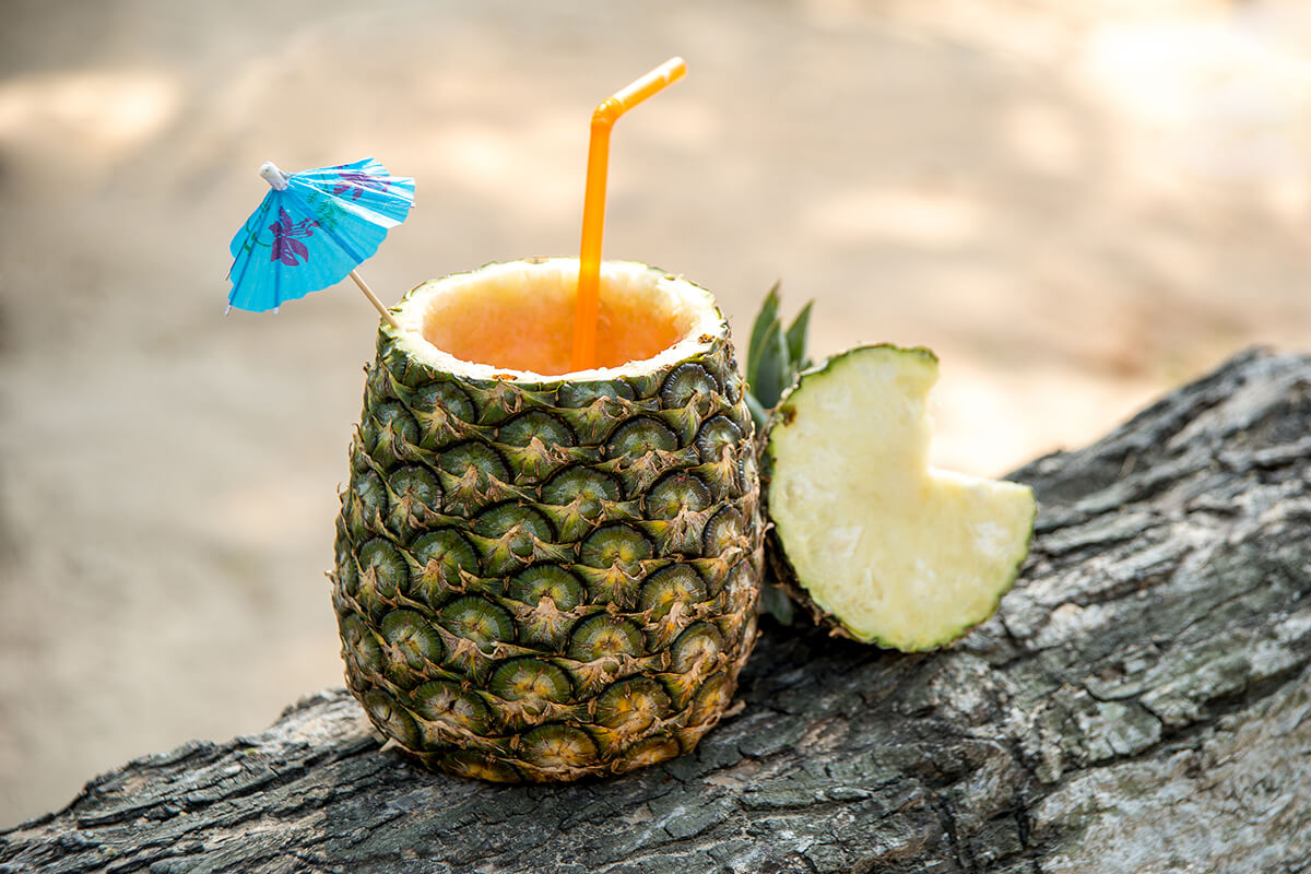 Image of a luau cocktail in a pineapple.